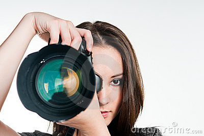 Young girl with professional camera
