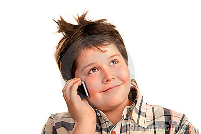 Funny young boy talking on the phone