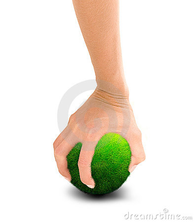 Hand holding green planet