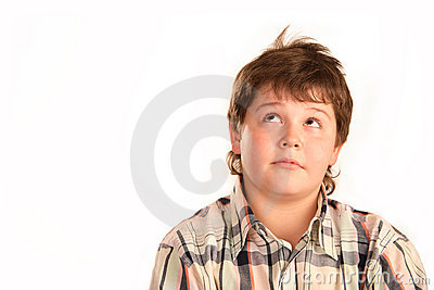 Pensive young boy looking up