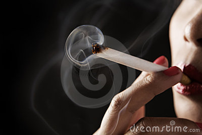 Woman smoking with smoke shaped like skeleton