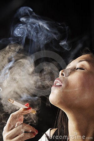 Female inhale smoke from cigarette