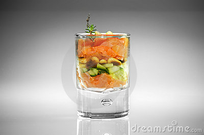 Appetizer in glass with salmon