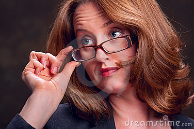 Business woman touching glasses