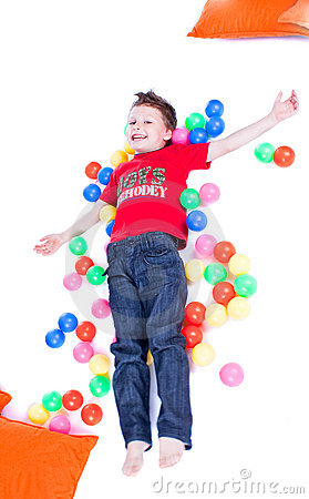 A lovely kid is playing with balls