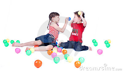A lovely kids are playing with balls
