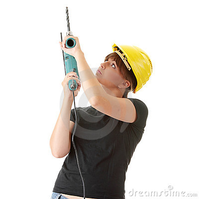 Young woman builder with driller