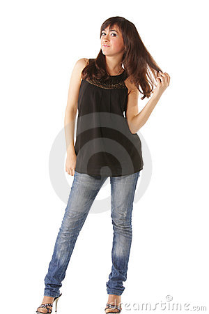 Woman in jeans touching hairs