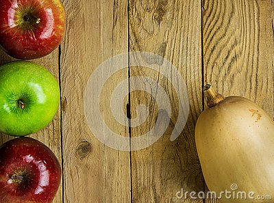 Butternut Squash Pumpkin Ripe Red Green Apple on Weathered Wood Background. Autumn Fall Thanksgiving Harvest. Copy Space