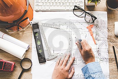 Top View Architect working on blueprint. Architects workplace. Engineer tools and safety control,