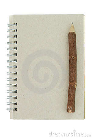 Wooden pencil and recycled notebook
