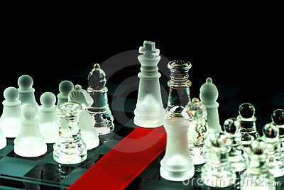 Chess and red ribbon on chess board