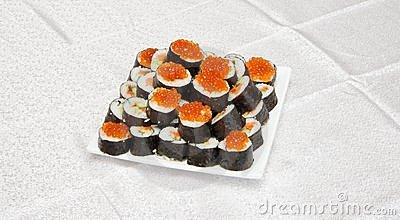 Homemade sushi with red caviar on white s