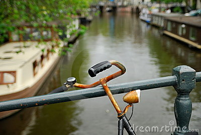 Dutch bicycle and canal in Amsterdam