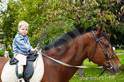 Little kid on big horse
