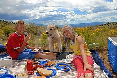Brother sister and dog on picnic