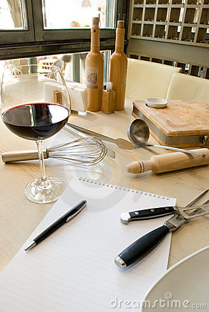 Utensils, notebook and wine