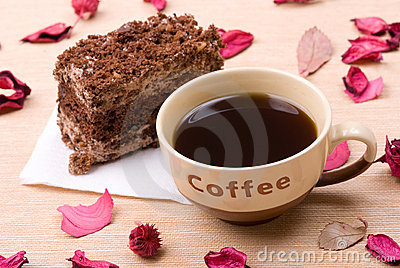 Biscuit cake with cup of coffee