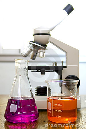 Beaker, flask and blured microscope