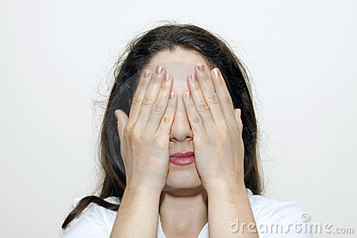 Woman closing her eyes with hands