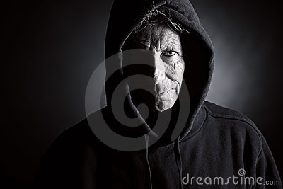Intimidating Senior Male in Hooded Top