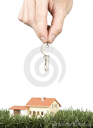 Hand with keys and a little house