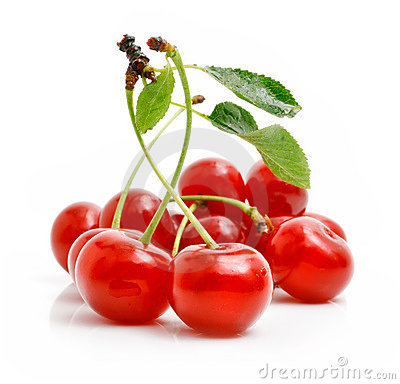 Fresh red cherries with green leaves