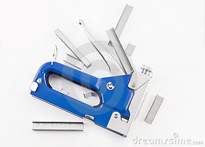 Blue staple gun with staples isolated over white