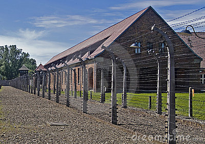 Wire fence and barrack in Auschwitz-Birkenau ca