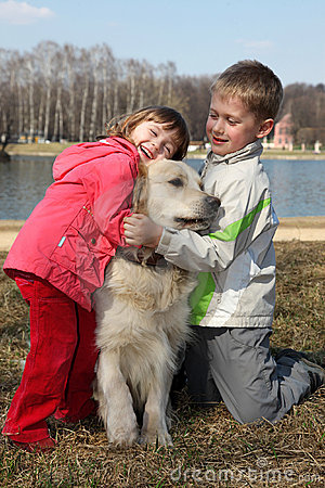 Children with retriever outdoor
