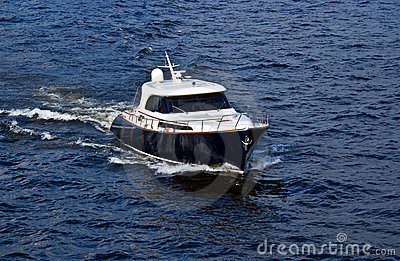 Fast white motor boat on blue water