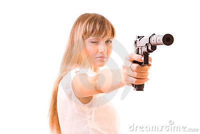 Young woman with gun isolated