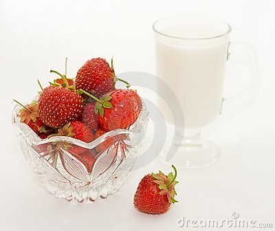 Glass cup with milk and berries