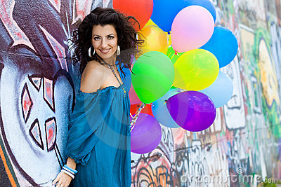 Happy woman with balloons