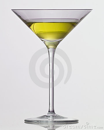 Yellow drink in cocktail glass