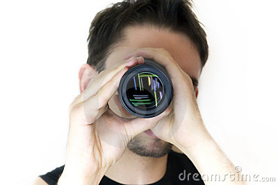 Man looking in an objective