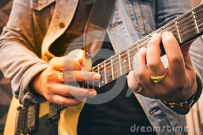stock image of a man playing the guitar