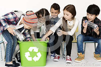 Group of children with a recycling symbol