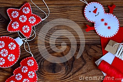 Easy Christmas crafts for adults or kids to make. Felt star, Christmas tree, snowman and ball on a brown wooden background