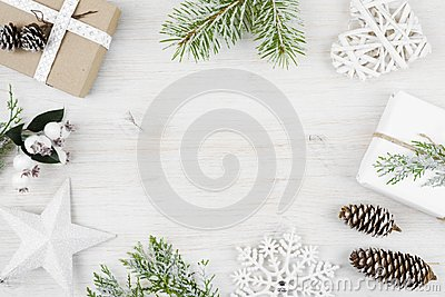 Christmas decoration, gift, frosted cypress branches, pine cones. Wooden background