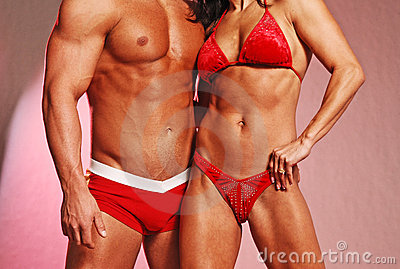 Fitness couple in red