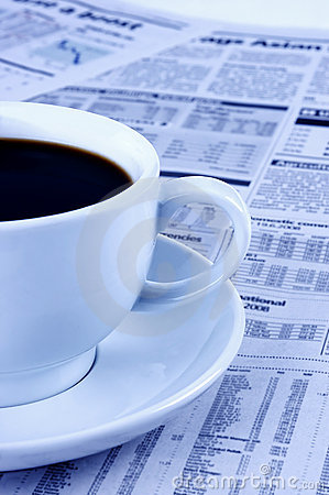 A cup of black coffee and a newspaper