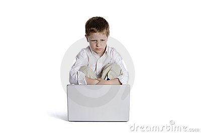 Child sitting in front of a laptop computer