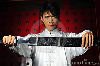 Young Asian Man unsheading a sword
