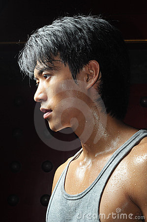 Young Asian Man Perspiring