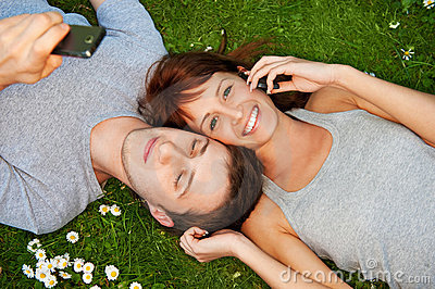 Couple with mobile phones outdoor