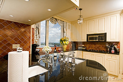 Kitchen in city apartment with skyline views