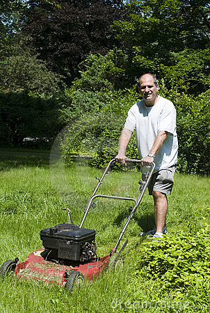 Man cutting grass at suburban house