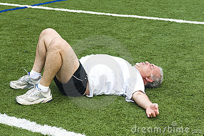 senior man stretching exercising