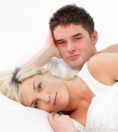 Portrait of a couple lying in bed